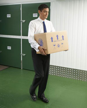 business man carrying documents to storage