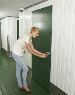 girl from huntingdon opening self storage unit at morespace storage near huntingdon in cambridgeshire