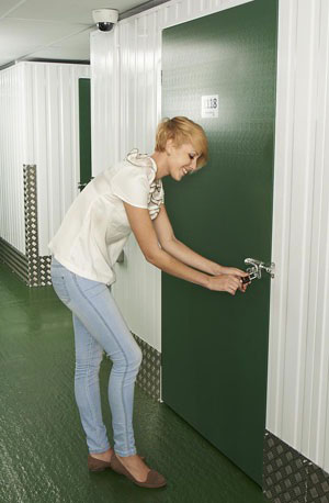 Girl unlocking household storage unit
